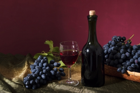 Still life with clusters of dark grapes and wine Stock Photo