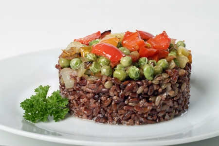 A delicious brown rice with vegetables and parsley