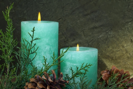 Two christmas candles on a dark green background photo