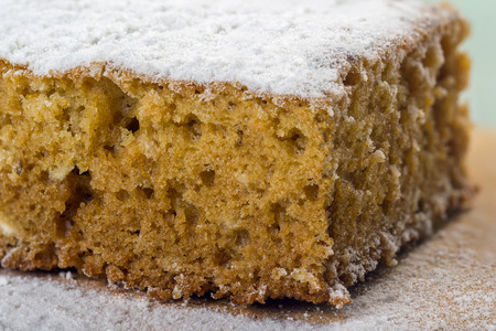 close-up of a honey cake in white powdered sugar
