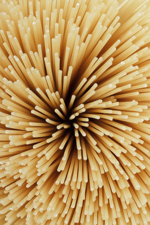 Uncooked pasta spaghetti macaroni, Top view, isolated on white background