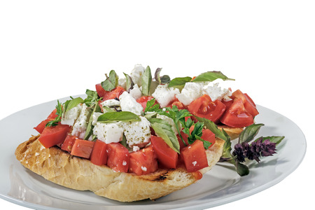 Traditional italian bruschetta tomatoes basil olive oil on baguette Stock Photo