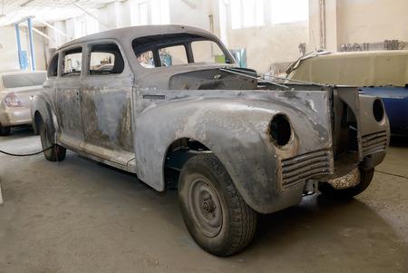Odessa, Ukraine-February 25, 2018: Vintage 1950 ZIS-110 during recovery in auto-moto repair shop in the city of Odessa, Ukraine.
