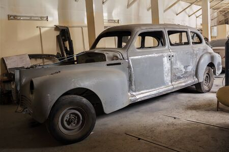Odessa, Ukraine-February 25, 2010: Vintage 1950 ZIS-110 during recovery in auto-moto repair shop in the city of Odessa, Ukraine.