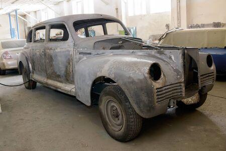 Odessa, Ukraine-February 25, 2018: Vintage 1950 ZIS-110 during recovery in auto-moto repair shop in the city of Odessa, Ukraine. Editorial