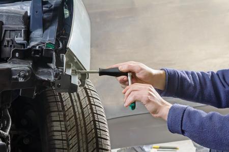 car mechanic repairs car bodywork of a vehicle after a traffic accident Standard-Bild