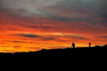 martians: Martians walking during sunrise Stock Photo