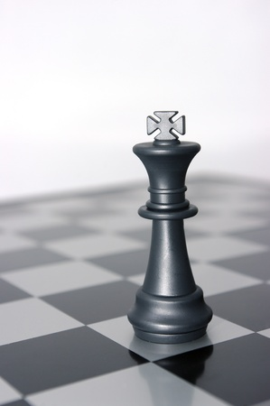 Black chess king alone on the battlefield