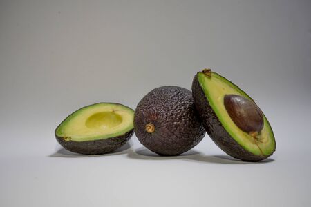 avocados presented on white background