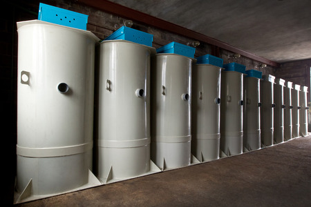 autonomic: A row of european septic tank stations (autonomous sewage system) at the warehouse Stock Photo