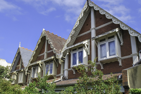 Top floor and classical roof gables in Sydney neighbourhood, inhabited by Asians Stock Photo