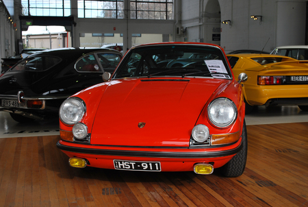 SYDNEY, AUSTRALIA - JULY 29, 2014: Fire red Porsche 911 Carrera car, old classic retro model on display for purchase