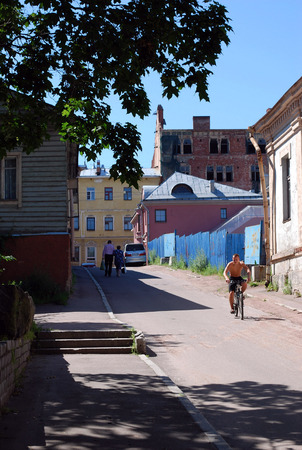Street scene at noon with natives in one of the old fashioned Vyborg neighbourhoods, Russian Federation Editorial