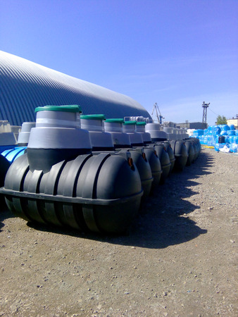 Septic tanks storage at the manufacturer factory ready for sale and pick-up Stock Photo