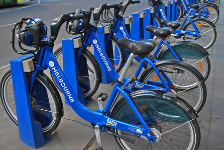 Melbourne, Australia - March 20, 2016: Bike share station is located at Flinders Street opposite Federation Square. People can rent bicycles and explore the city. Editorial
