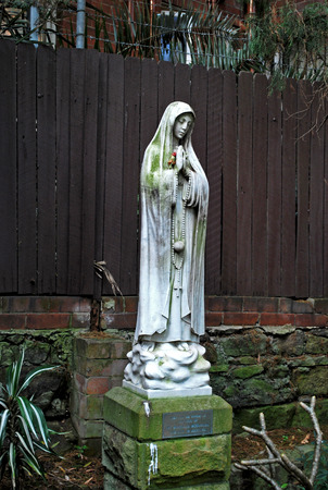 Nun statue in Peace Park of St. Canices Parish, praying for the repose of the soul