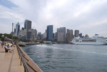 Sydney, Australia - November 02, 2015: Circular Quay embankment on a cloudy day with a cruise ship in the harbor