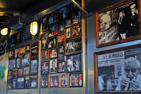 Sydney, Australia - July 11, 2014: Frames with photos of famous guests on the wall at Harrys Cafe de Wheels. Harrys Cafe de Wheels is an iconic pie cart in Woolloomooloo suburb, New South Wales, on Cowper Wharf Road.