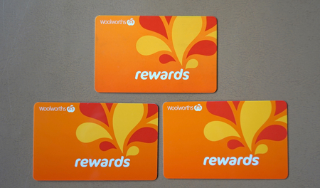 Sydney, Australia - October 15, 2017: Group of Woolworths Rewards loyalty cards. Woolworths Supermarkets is an Australian grocery store chain, along with Coles together accounting for about 80% of the Australian market. Editorial