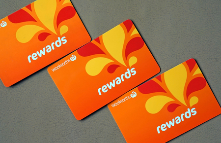 Sydney, Australia - October 15, 2017: Close-up of Woolworths Rewards loyalty cards. Woolworths Supermarkets is an Australian grocery store chain, along with Coles together accounting for about 80% of the Australian market.