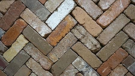 Zigzag diagonal lines of rustic color palette brick slabs