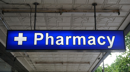 Unspecified universal Pharmacy neon sign above the entrance to the chemist drug store Banco de Imagens
