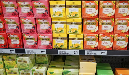 Sydney, Australia - October 17, 2017: Variety of fruity Twinings Tea 20g packs (Berries, Ginger & Apple, Lemon) on display in grocery store. Twinings brand is owned by Associated British Foods.