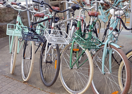 Several Lekker Double Dutch bicycles parked outside of bike shop