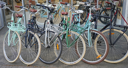 Vintage Lekker bicycles parked nicely in a row outside bike shop. Editorial