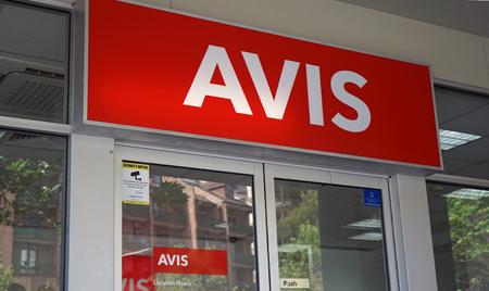 Sydney, Australia - October 17, 2017: Avis logo above the Sydney CBD branch entrance. Avis is an American car rental company headquartered in New Jersey, United States.