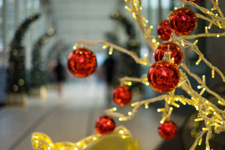 knick: Red christmas balls hanging on the lighting tree Stock Photo