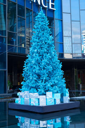 Blue christmas tree with gifts Stock Photo
