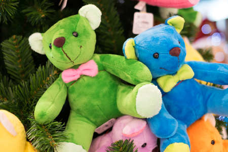 Colourful bears hanging on the christmas tree