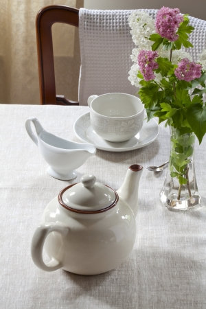 Teapot Milk Jug A Tea Cup On Saucer Flowers In A Vase Stock Photo
