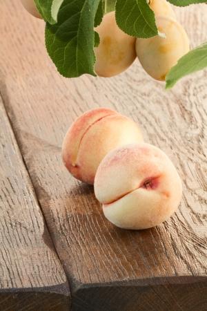 goldish: Ripe goldish velvety peaches and yellow plums Stock Photo