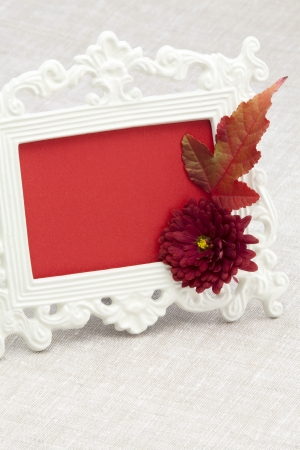 Vintage photo frame chrysanthemum and autumnal a maple leaf photo