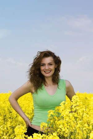 Portait of a happy young woman in the rape flower field photo