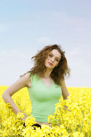 Portrait of a young woman in rape flower field