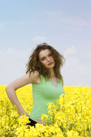 Portrait of a young woman having fun in the rape field photo