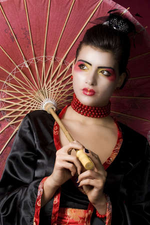 Studio portrait of a beautiful geisha