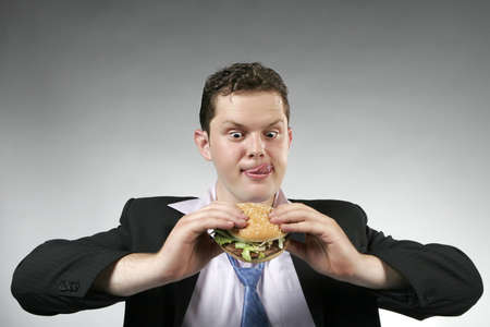 Businessman anxious to eat his lunch. Studio shot Stock Photo