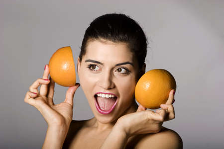 Portrait of a beautiful woman with grapefruit. Studio shots. Part of a series. Stock Photo - 6759903