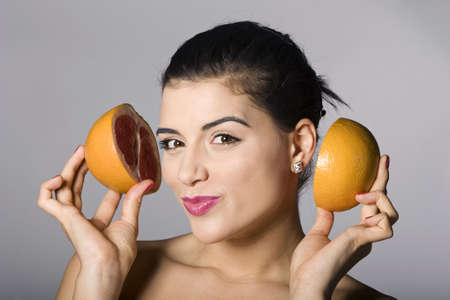 Portrait of a beautiful woman with grapefruit. Studio shots. Part of a series. Stock Photo - 6759906