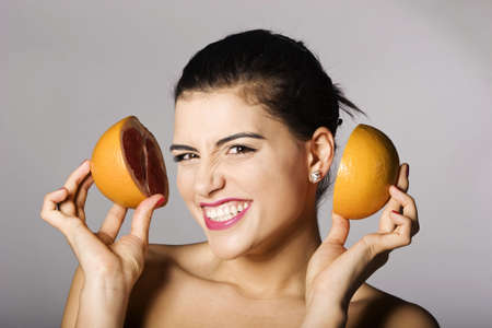Portrait of a beautiful woman with grapefruit. Studio shots. Part of a series. Stock Photo - 6759912