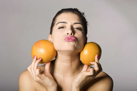 Portrait of a beautiful woman with grapefruit. Studio shots. Part of a series. Stock Photo - 6759907