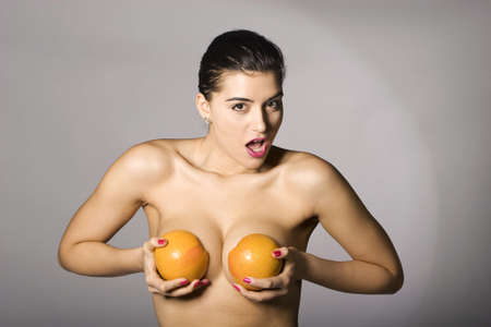 Portrait of a beautiful woman with grapefruit. Studio shots. Part of a series. Stock Photo - 6759904