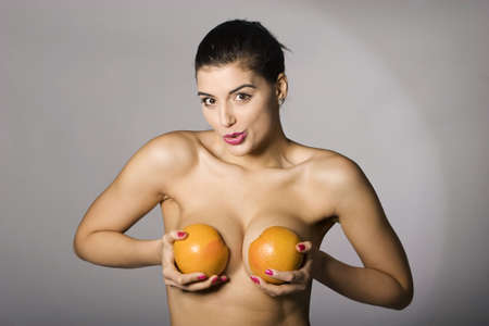 Portrait of a beautiful woman with grapefruit. Studio shots. Part of a series. Stock Photo - 6759897