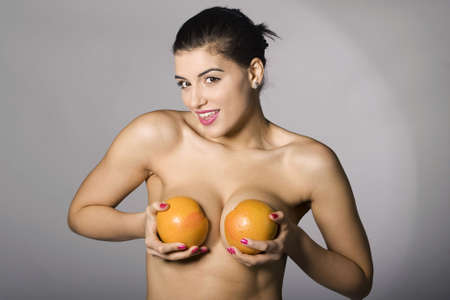 Portrait of a beautiful woman with grapefruit. Studio shots. Part of a series. Stock Photo - 6759893