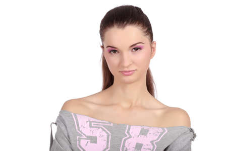 Front view of a beautiful young girl, dressed in a casual 58 t-shirt, wearing pink, natural make-up.