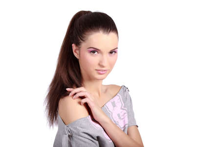 Portrait of a pretty young woman with ponytail hair and pink natural makeup. High resolution image taken in studio. Isolated on pure white background with copy space for your ad.